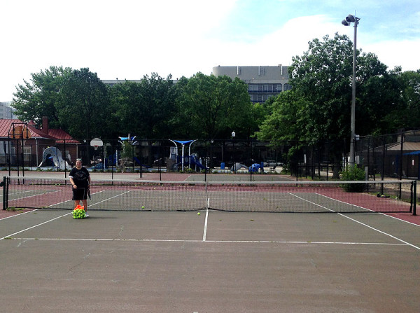 My very friendly and patient (with my rusty backhand) instructor greets me on the court